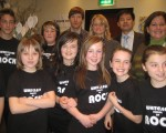 Eco-Schools USA staff shown with Whitelees School of Rock musicians and music director